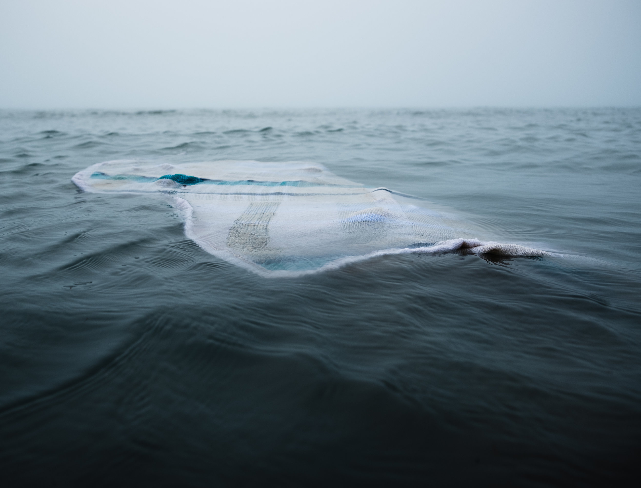 Staysail (Drifting) , Photographic Documentation of Performance with Handwoven Sail, 2018  photo credit  Ben Dembroski    Read more about the making of this image .