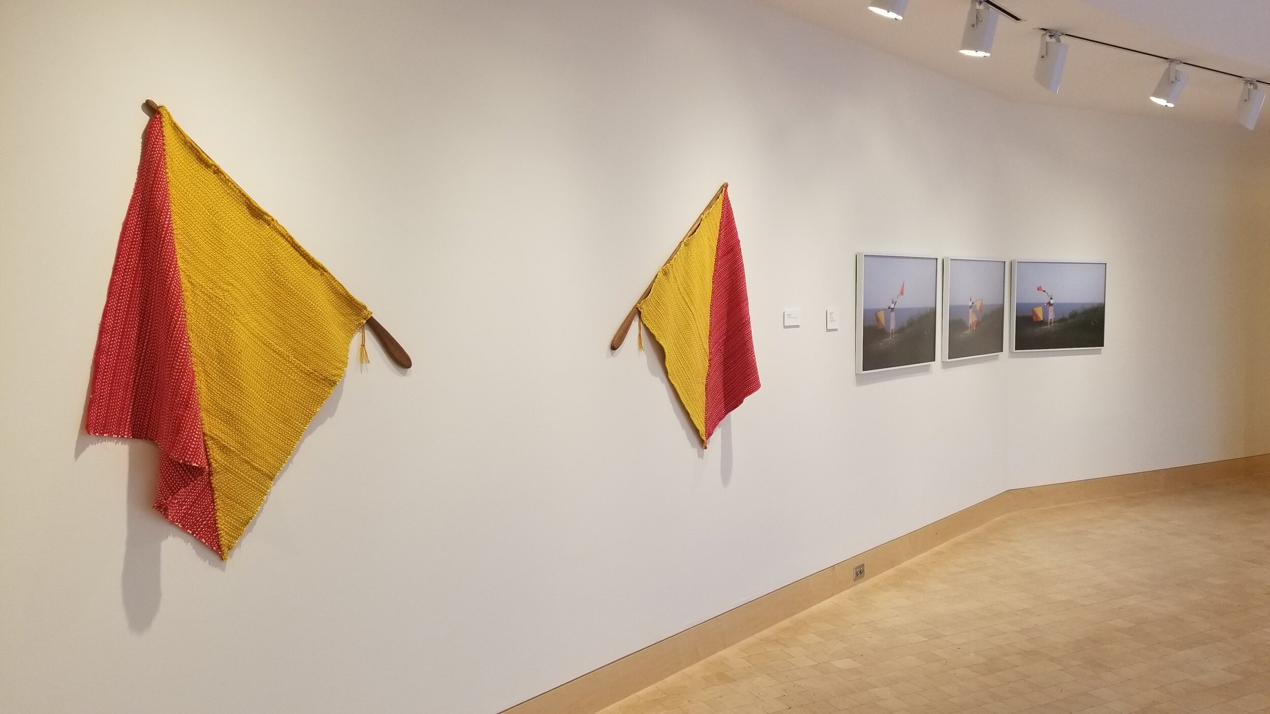 Y.H.W. , Handwoven flags with carved mahogany, photographic documentation of performance with flags, 2018