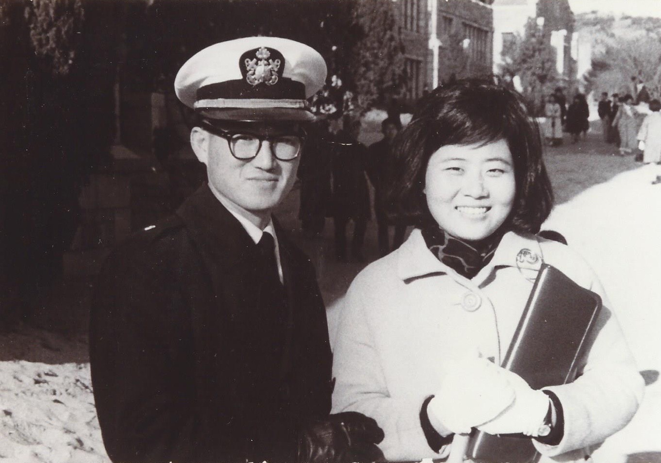 At his wife's college graduation, in his Navy uniform