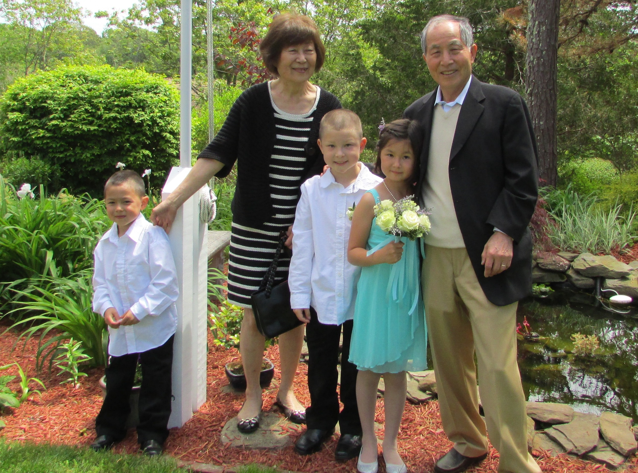 With his wife, Chan Soon Cho, and his grandchildren, on Cape Cod, 2014