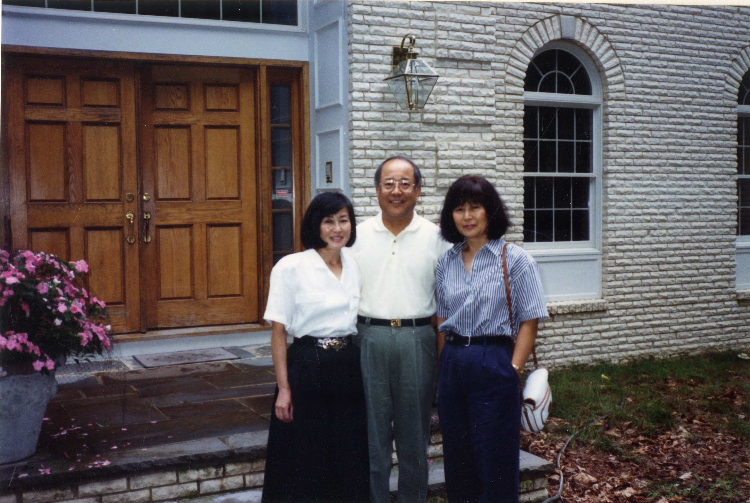 With her sister and brother, 2001
