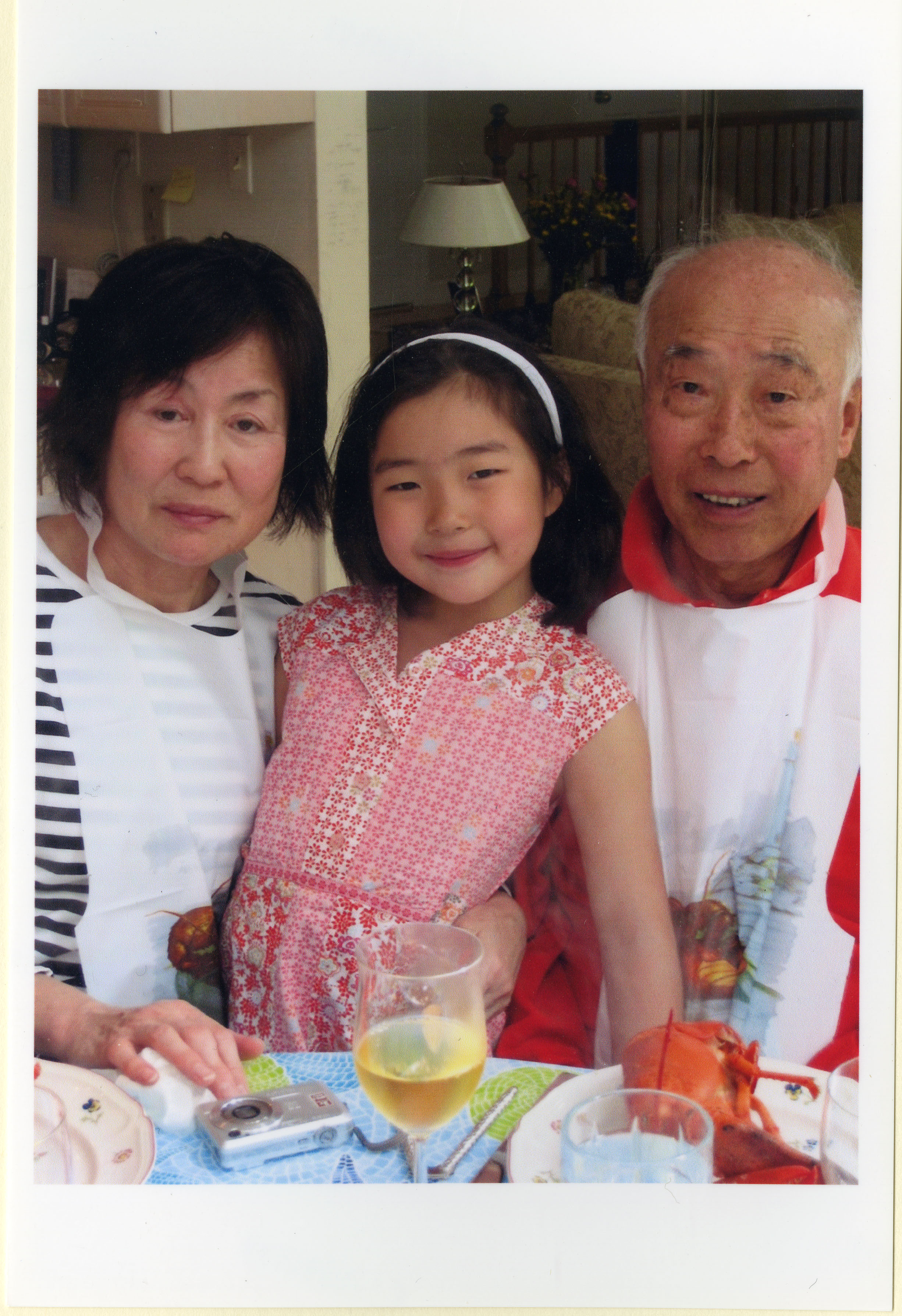 Chan Eai and Kook Dong Pae with their grandchild, 2006