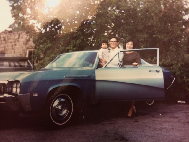 Joong Oh Rhee and his family in Johnson City, NY, with their first car, 1968
