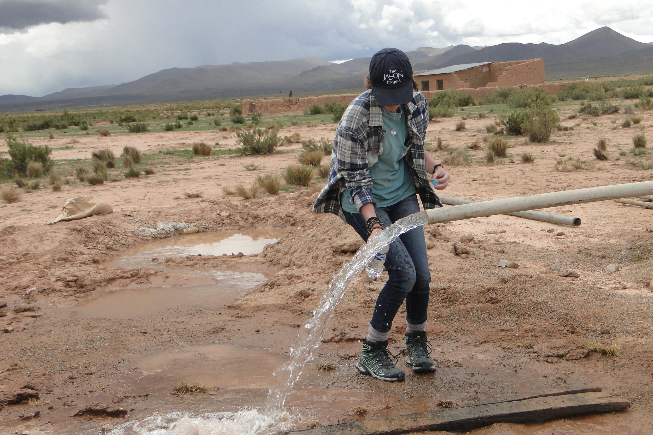 Erin Walsh collects water samples from the deep well for future quality tests.