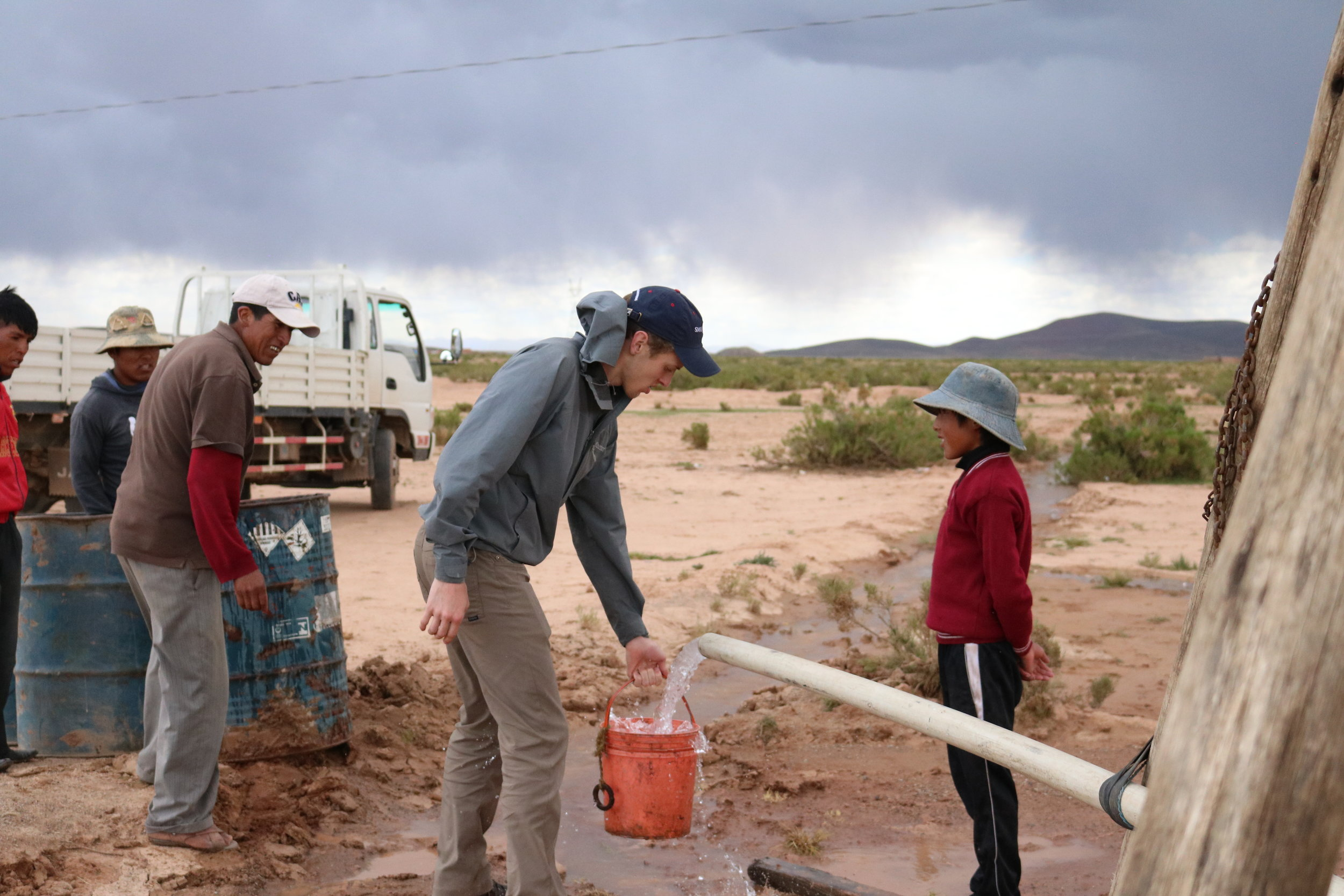 Andrew Timmins shows Gustavo water from the deep well.