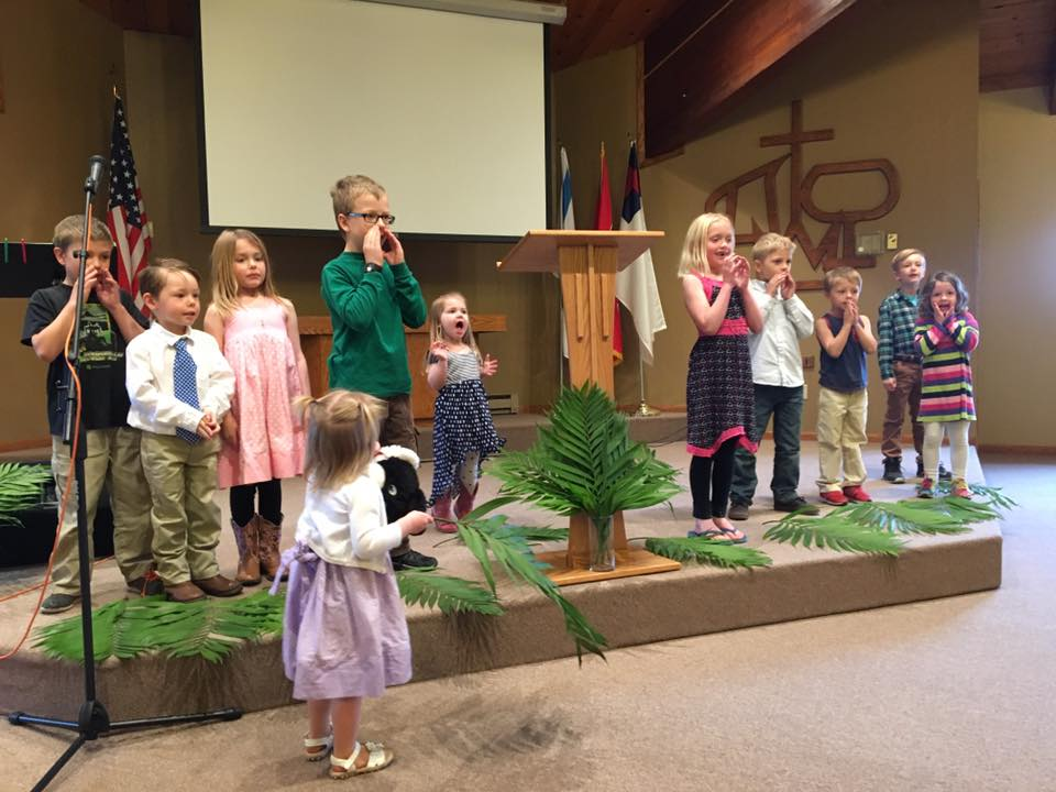 Kids leading us in worship on Palm Sunday