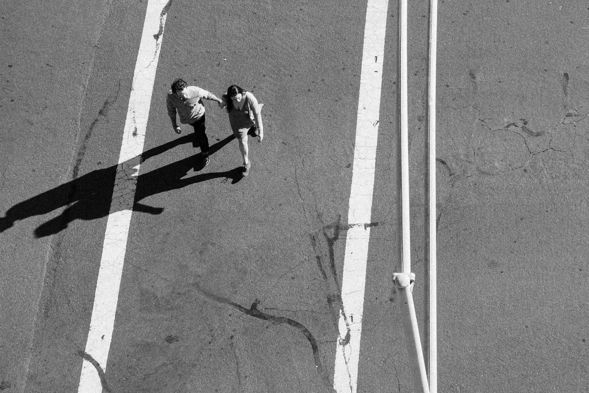 An engaged couple crosses an intersection in San Diego's North Park Neighborhood.