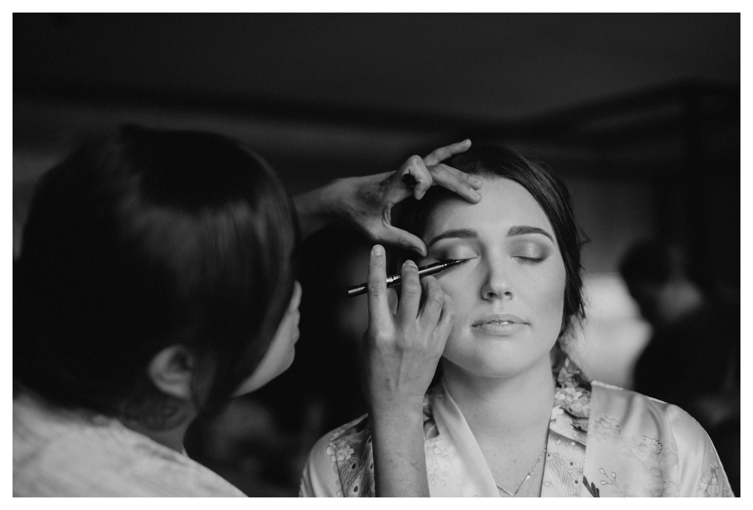 The bride has her make-up applied on her wedding day