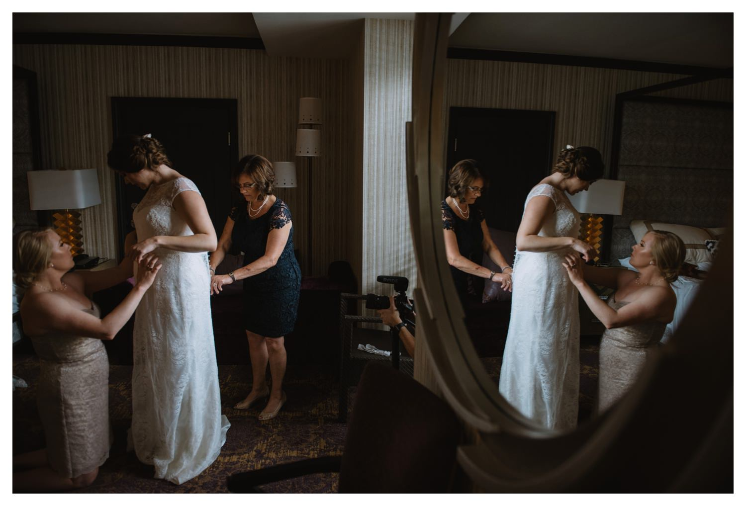 The reflection of a bride and her mother in a  mirror
