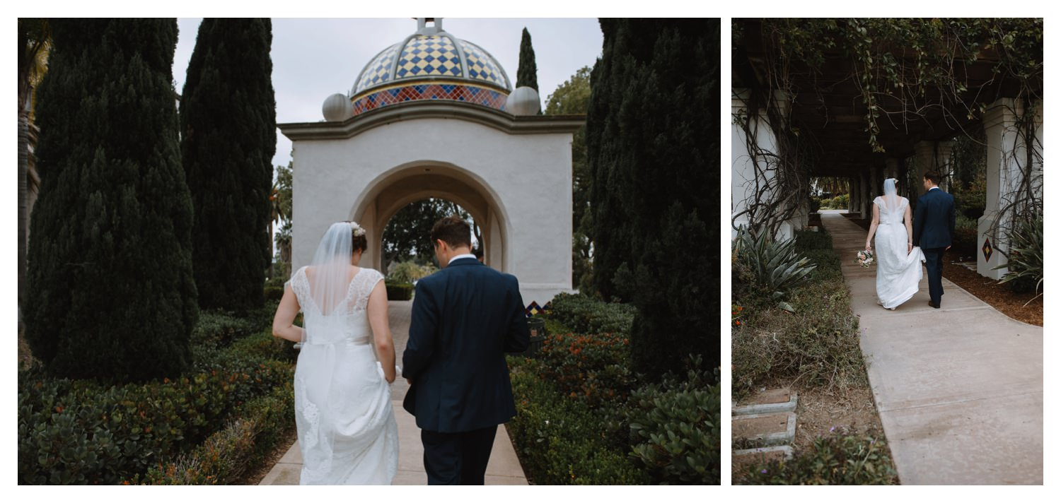 A bride and groom walk together at Balboa Park in San Diego