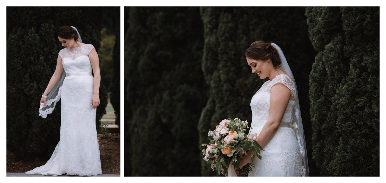 a bride inspects her wedding dress