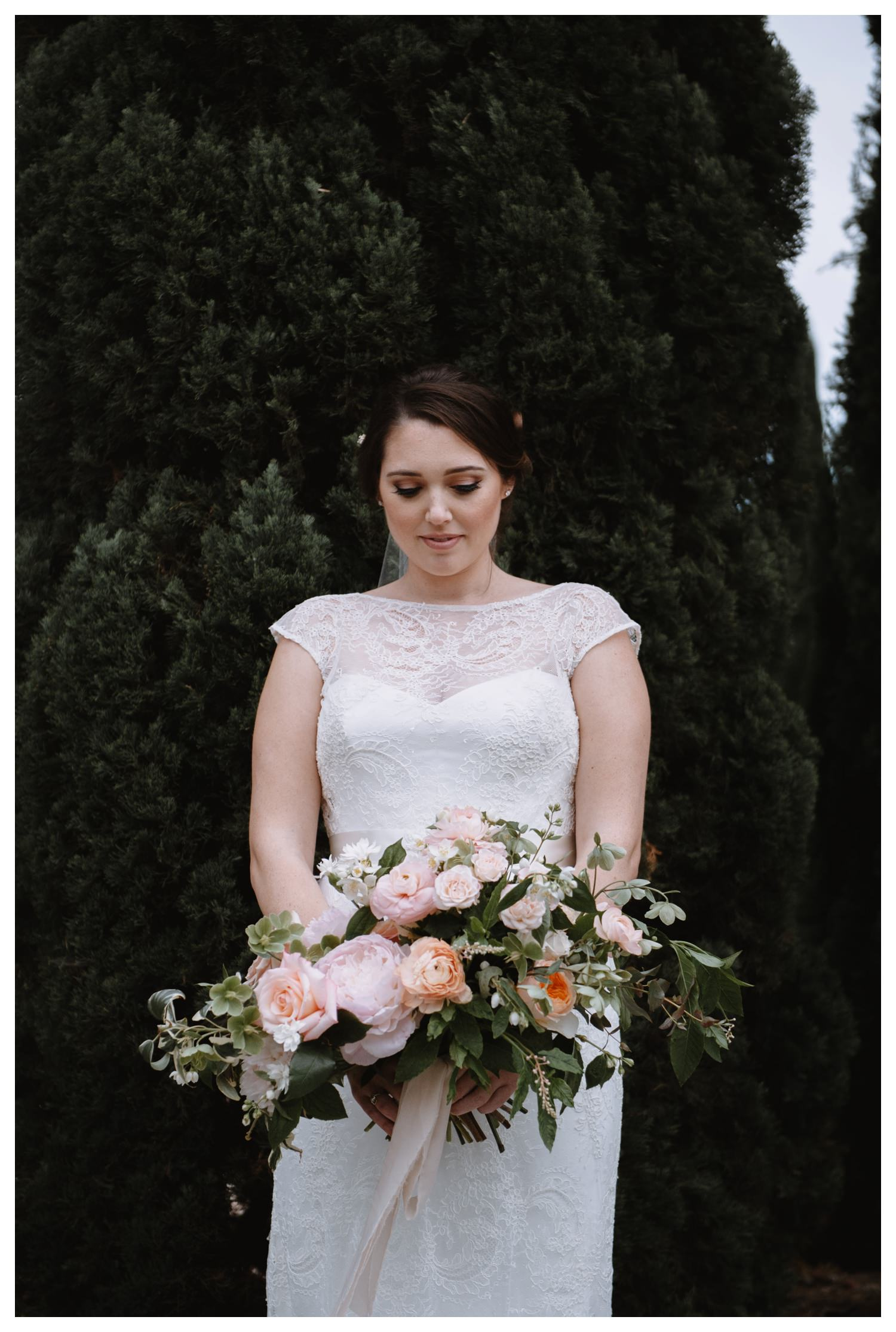 Beautiful pale pastel colors surround a bride on her wedding day