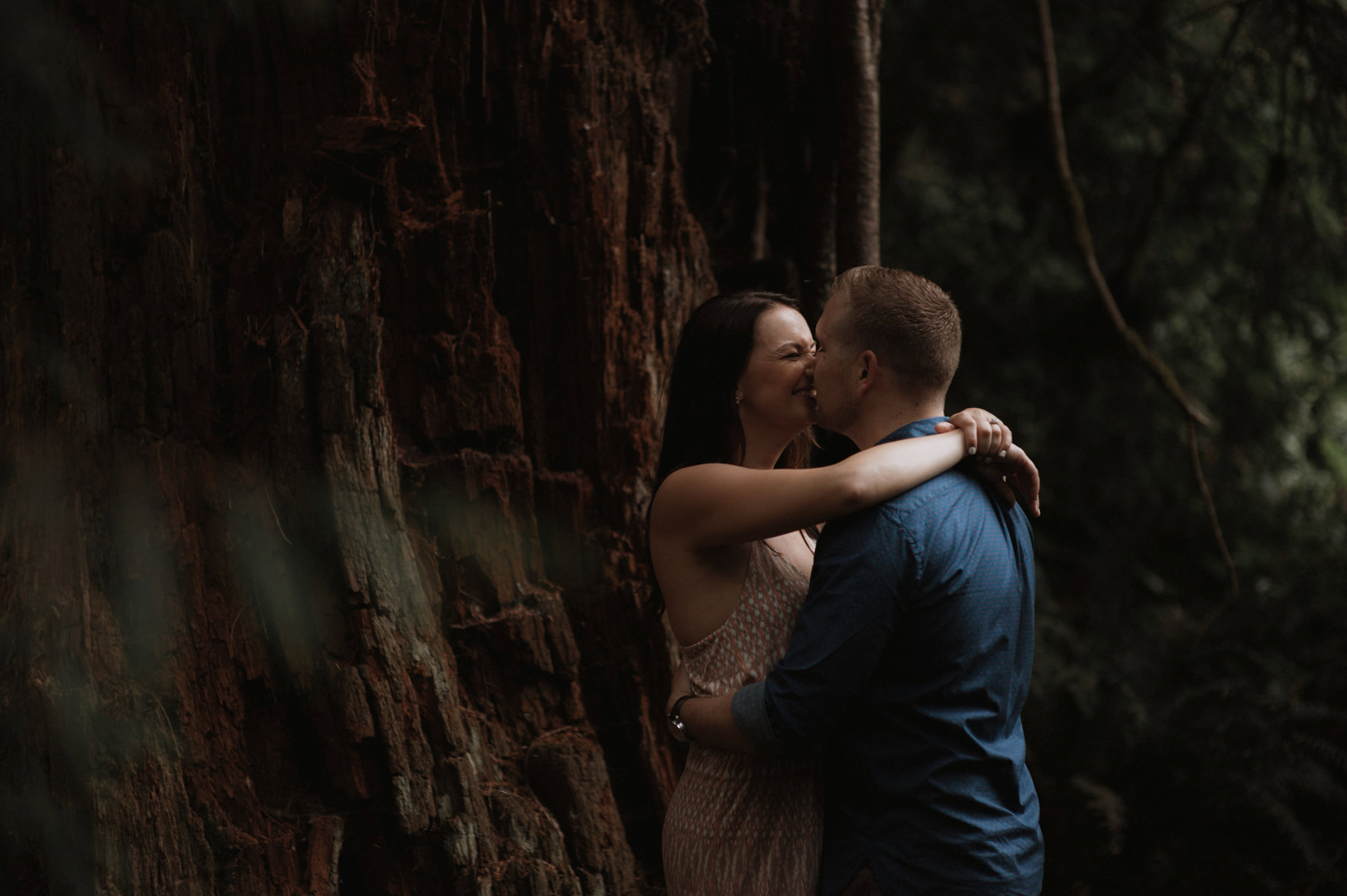 a couple kissing in the dark woods of Washington state