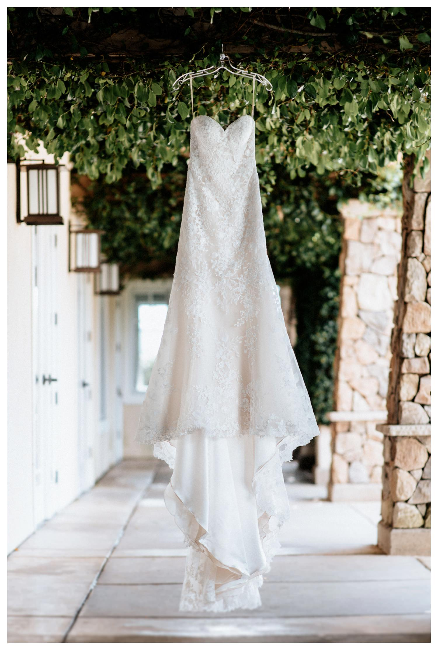 A wedding dress hangs in the breeze at Twin Oaks Golf course in San Marcos, CA