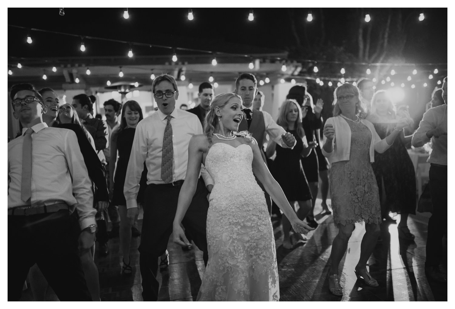 The bride and a following crowd do the Bernie dance during the reception.