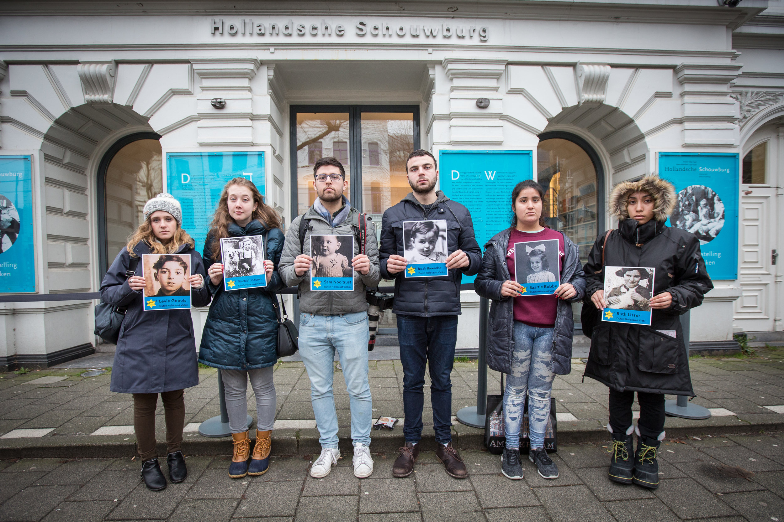 The Hollandsche Schouwburg (Dutch Theater) was used as a deportation center. In front of the theater, which is now a museum, Student Fellows held the names and faces of Dutch children who were killed during the Holocaust to honor their legacies.