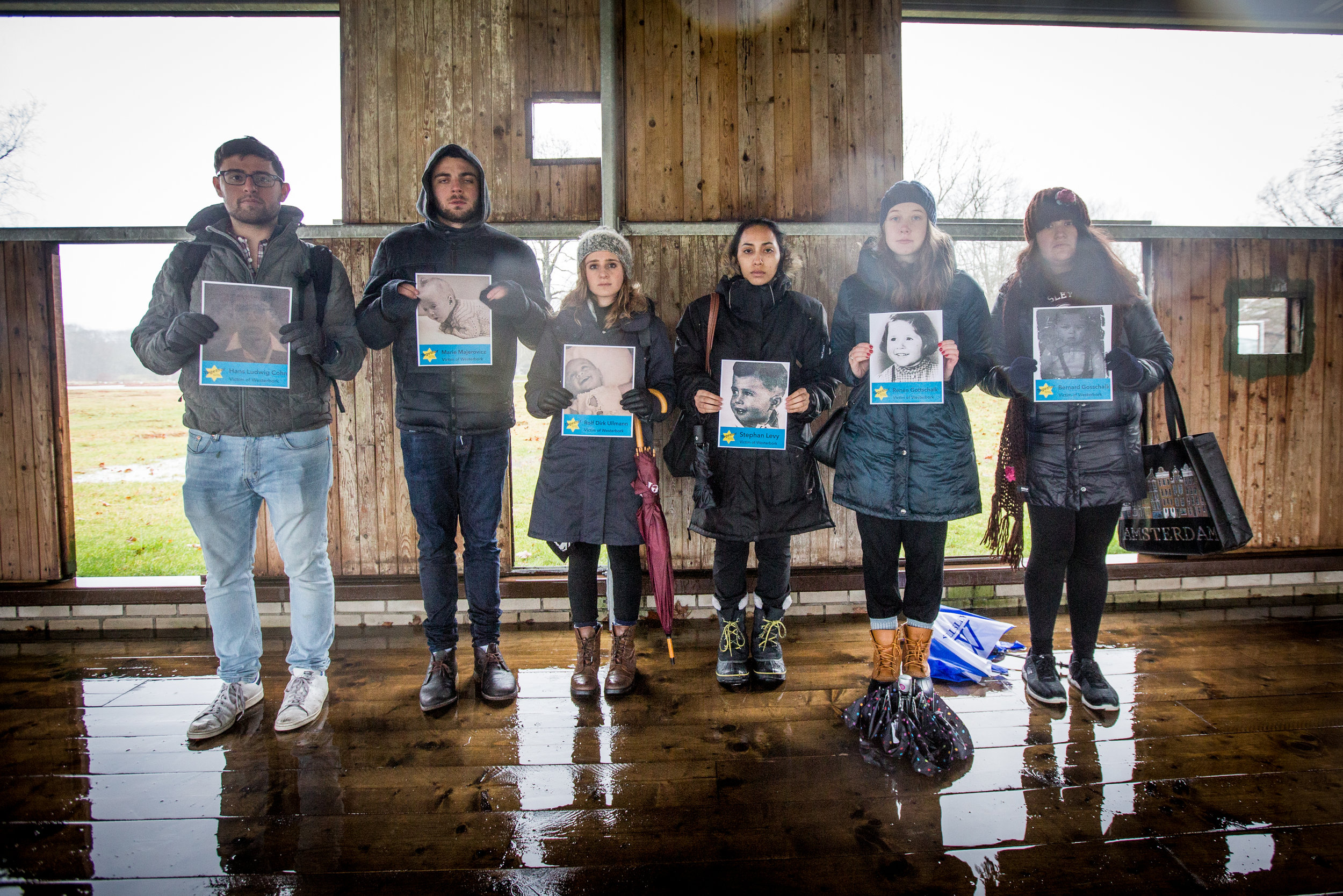 The Westerbork Transit Camp imprisoned thousands before deportation to death camps. In a brief refuge from a storm in the remains of a barrack, Fellows held the pictures of children who were ripped away from their homes and taken to the camp.