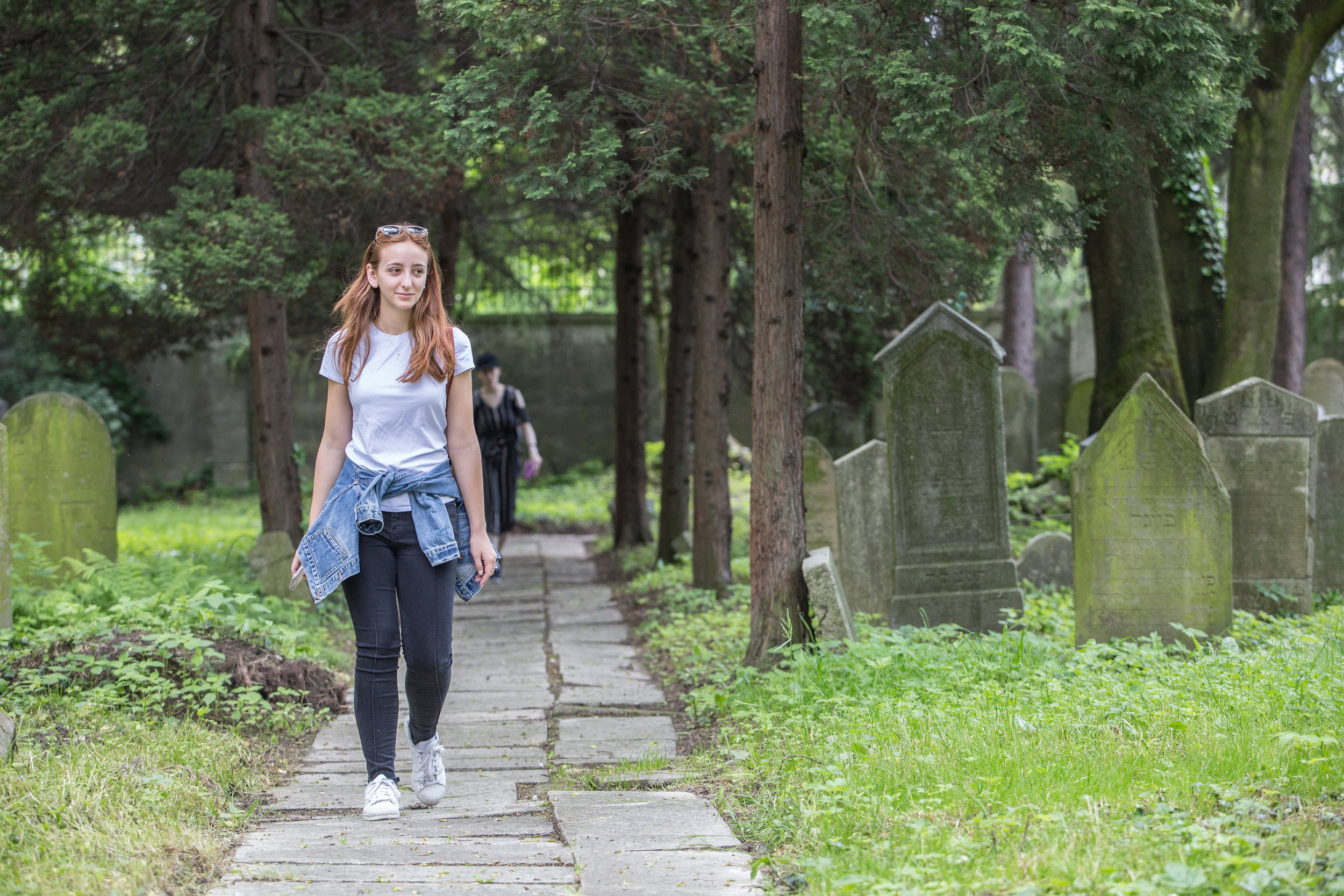 Kalen Michals walks through the Jewish cemetery on May 27, 2019 in Oswiecim, Poland. (Photo by Elan Kawesch/TRTN)
