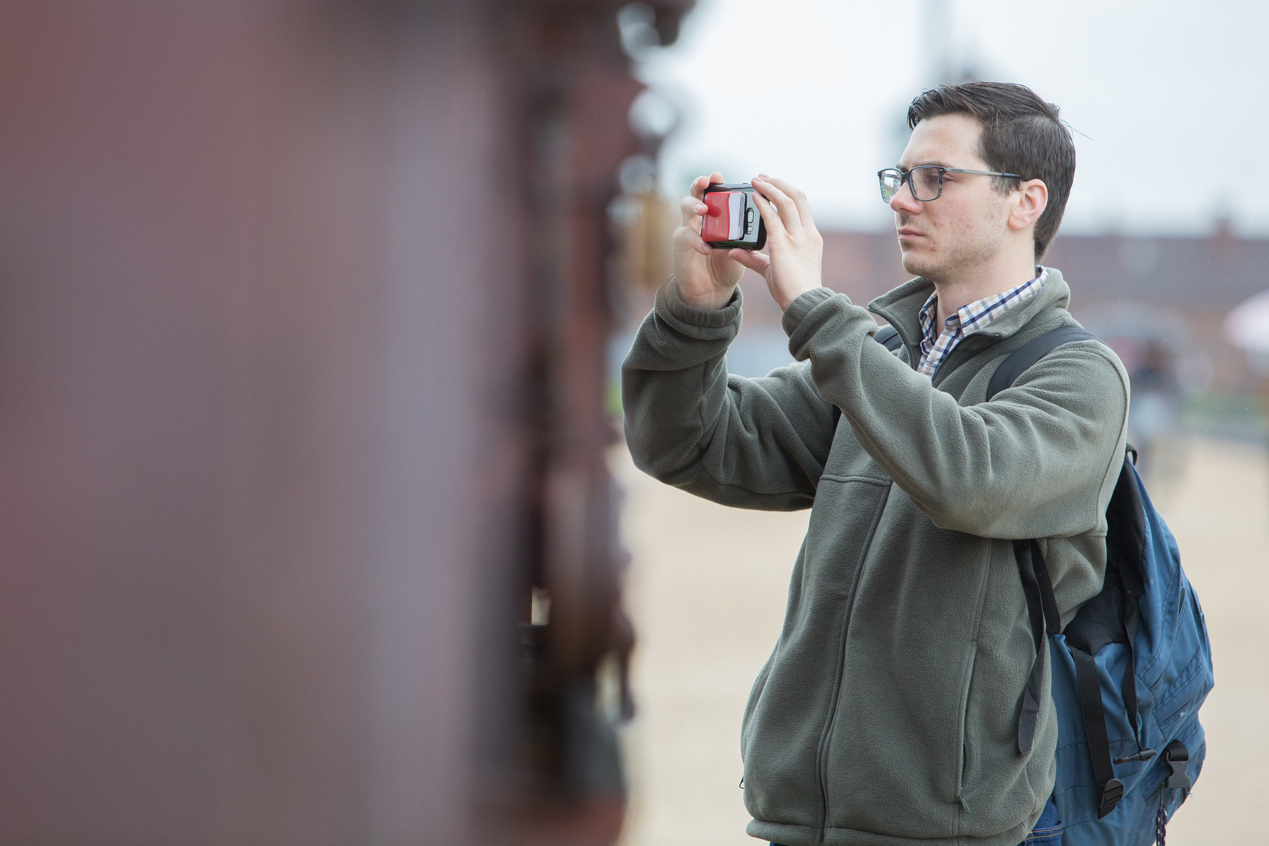 Michael Meagher photographs the boxcar at Auschwitz II - Birkenau on May 30, 2019.