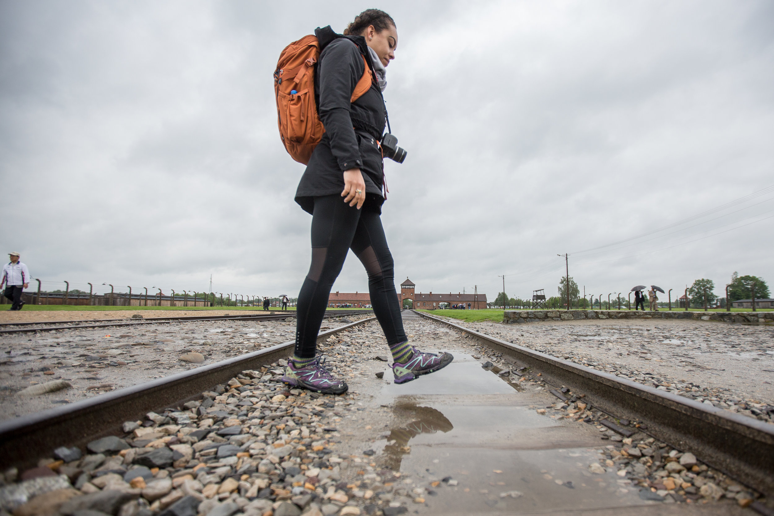 Cheyenne Paris walks on the tracks at Birkenau on May 29, 2019.