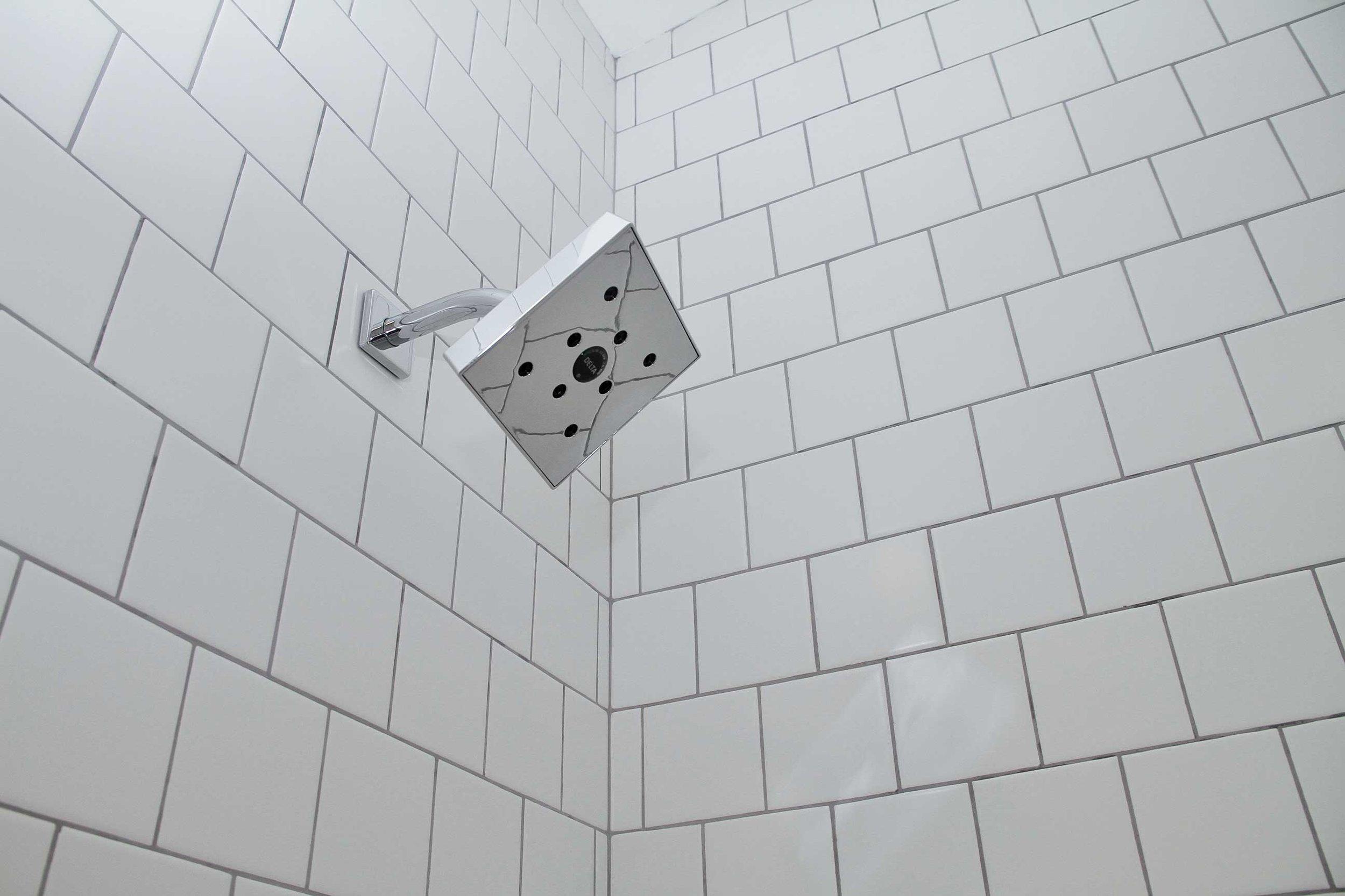 Full bathroom remodel by divine hardwood & Stone
