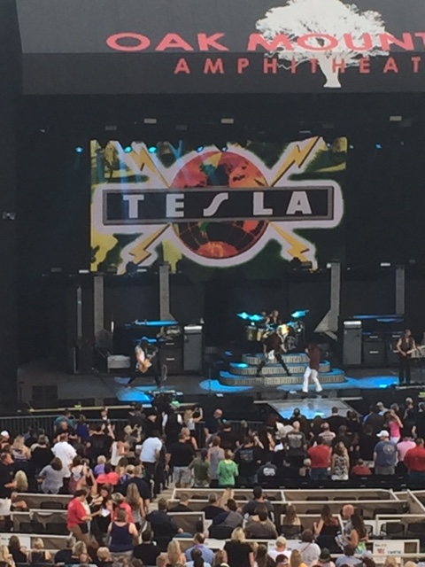 Tesla takes the stage... at least that's what the sign says. (They're everywhere so I understand)