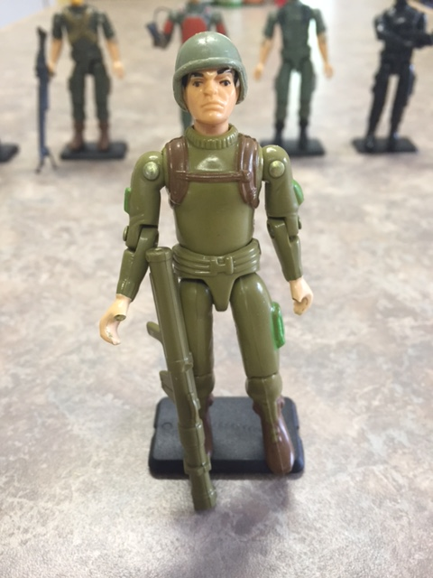 Zap the bazooka soldier from G.I. Joe 1982 (straight arm version).  The thumbs are infamously brittle.