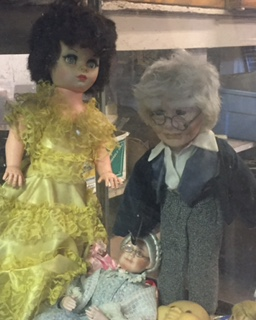 Tonya spotted these totally not creepy dolls in a dust covered case inside the main building.