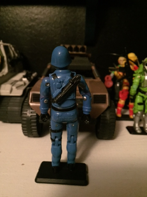 "Cobra commander came with a weird, vented, ""laser pistol"" which snapped onto his back.  see the video for more details."