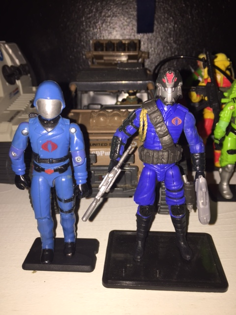 cobra commander's movie updated version further modifies the uniform and especially the helmet.  the cobra commander character in the G.I. Joe movies is a radically different character than the one portrayed in either the marvel comics series or the cartoons.