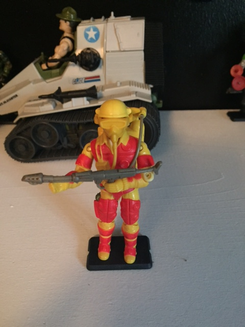 There is a lot to like about 1984's Blowtorch. His bright red and yellow outfit, removable mask, and bulky sculpt set him apart from the other G.I. joe action figures of the time.