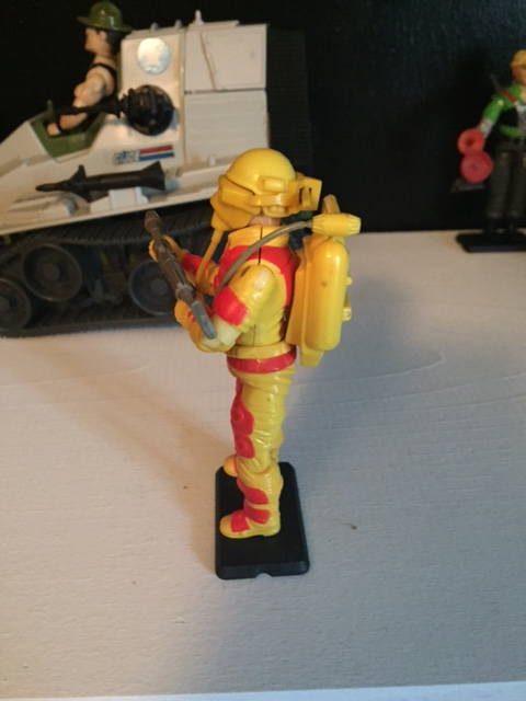 Profile of Blowtorch. his protective mask looks really cool in profile and you can see the flamethrower plugged into the front of the backpack.