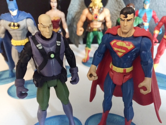 "Lex Luthor in his classic super friends purple, black, and green outfit verses  the best 3.75"" superman  (except for the big hands)."