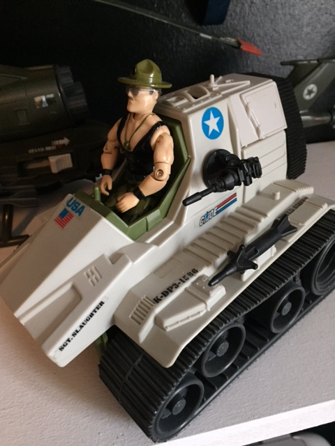 Sgt. Slaughter with the Triple T tank.  A ridiculous Joe vehicle that put the driver right up in harms way.  Yo Joe!