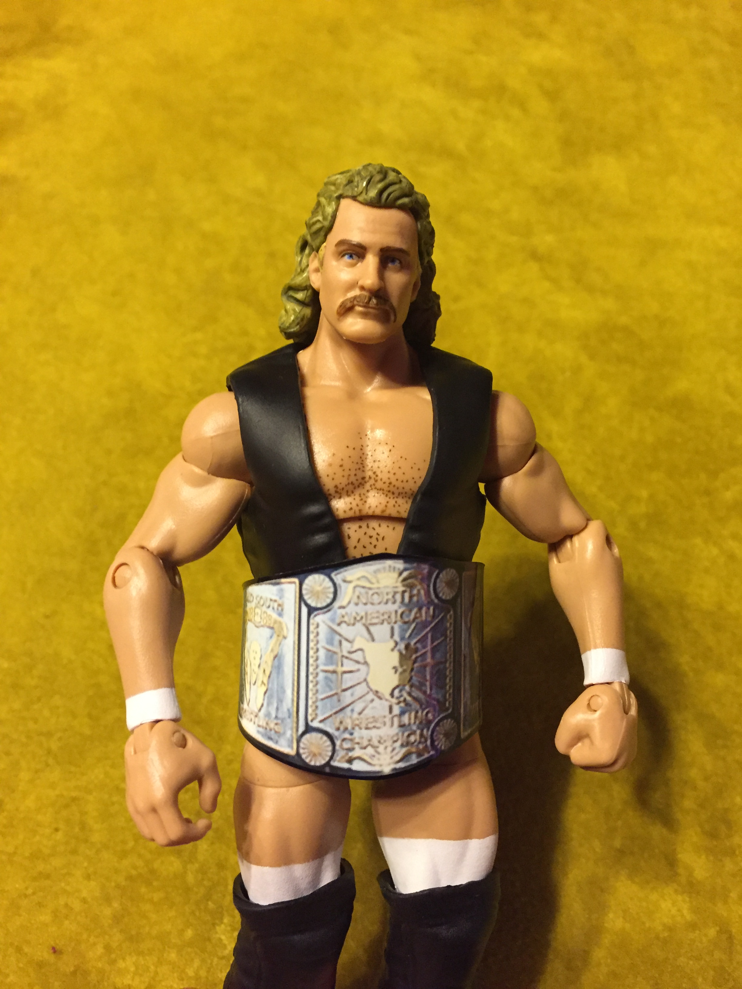 Here is magnum T.A. by mattel.  the north american championship belt is a custom belt i ordered off of ebay.  i think it helps nicely dress out the figure.
