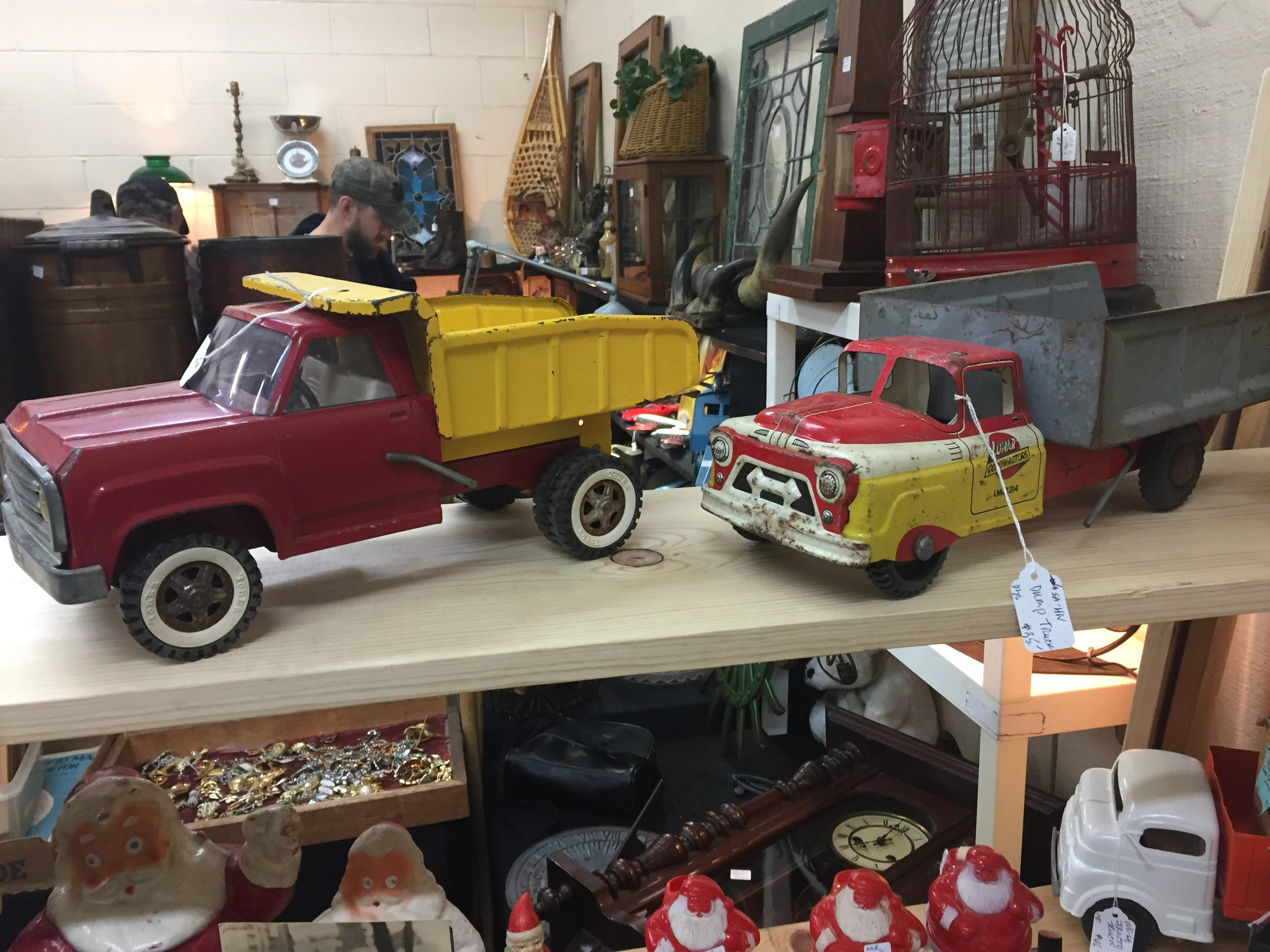 These old toy trucks were at the same booth as the teddy bears.  i wish i knew more about these.
