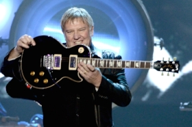 """Alex lifeson of Rush demonstrates a """"guitar"""""""