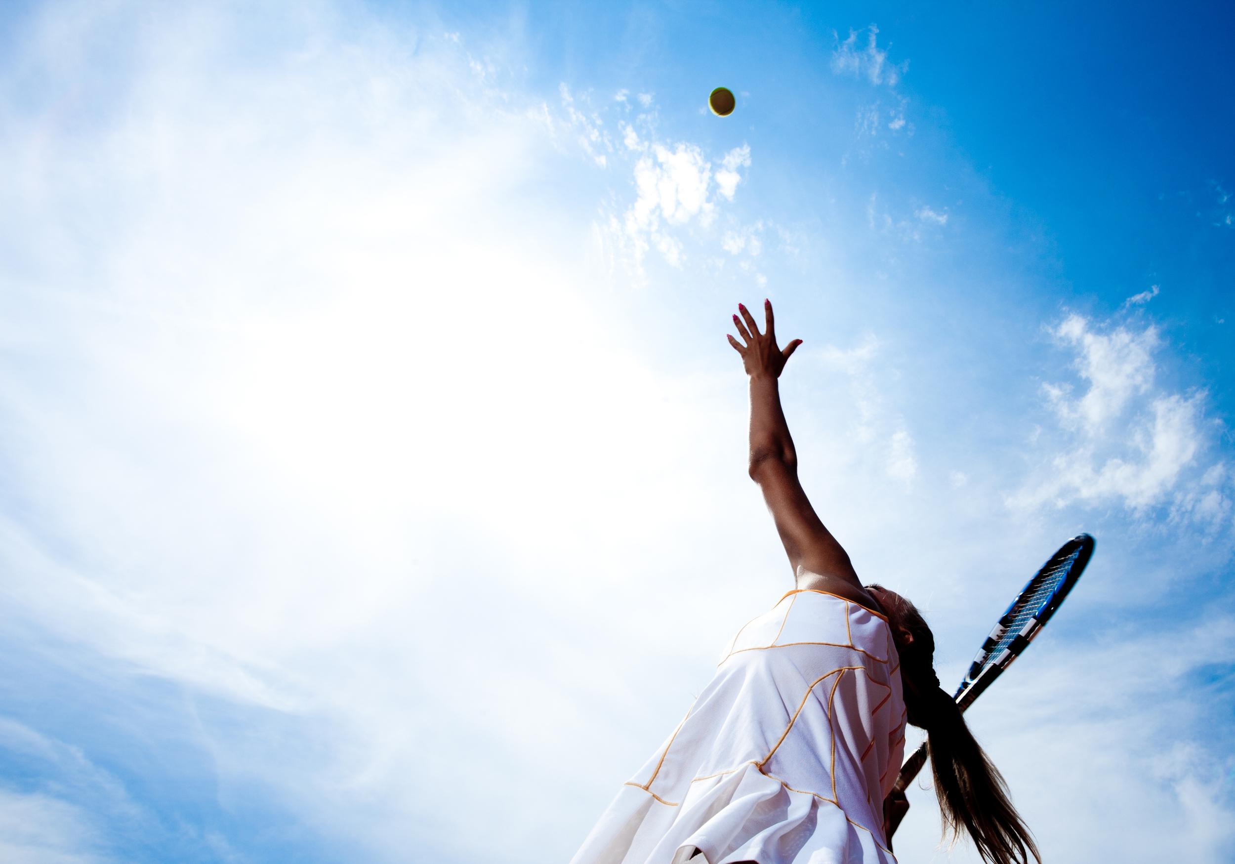 shutterstock - blue sky & girl tennis.jpg