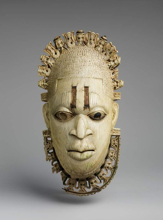 Scarification are visible on the the ivory mask of queen Idia of the Edo people of Benin City (Nigeria 16th Century). This was also in the movie by the way. The museum scene obviously.