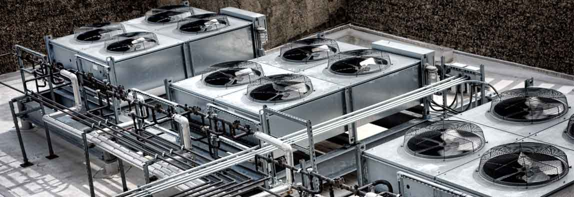 Commercial HVAC Calgary heating and cooling units on a roof