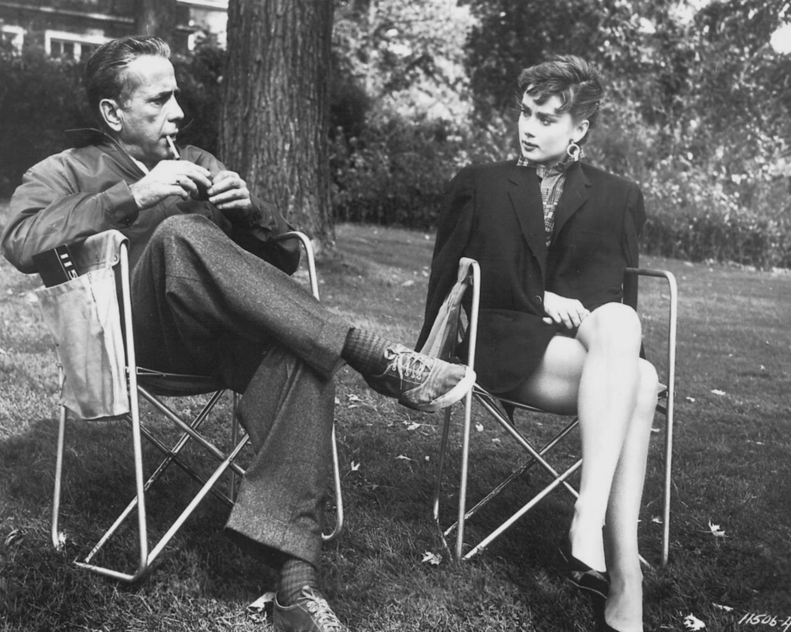 Audrey Hepburn and Humphrey Bogart on the set of Sabrina, 1954.