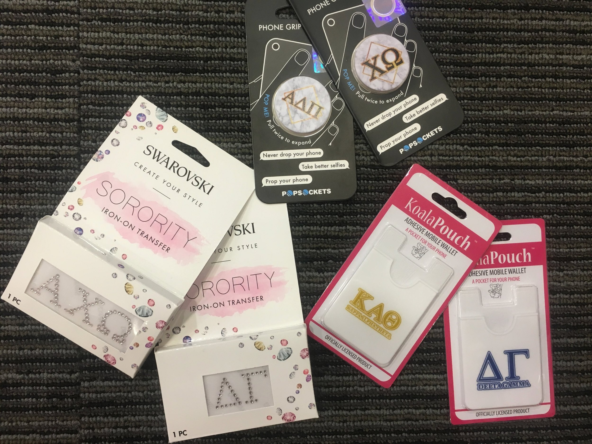 Assorted Phone Accessories - Jewel Iron-ons: $15.99Pop Sockets: $15.00Card Cases: $7.99