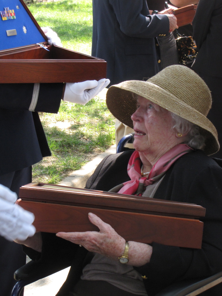 Rosemary Pearce receiving the flag from her son's coffin. Photo courtesy of Pearce family.