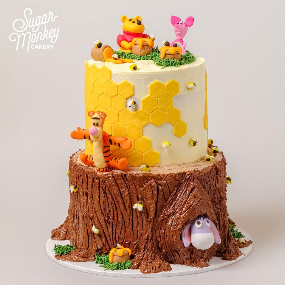 Winnie the Pooh birthday cake - tree stump and beehive