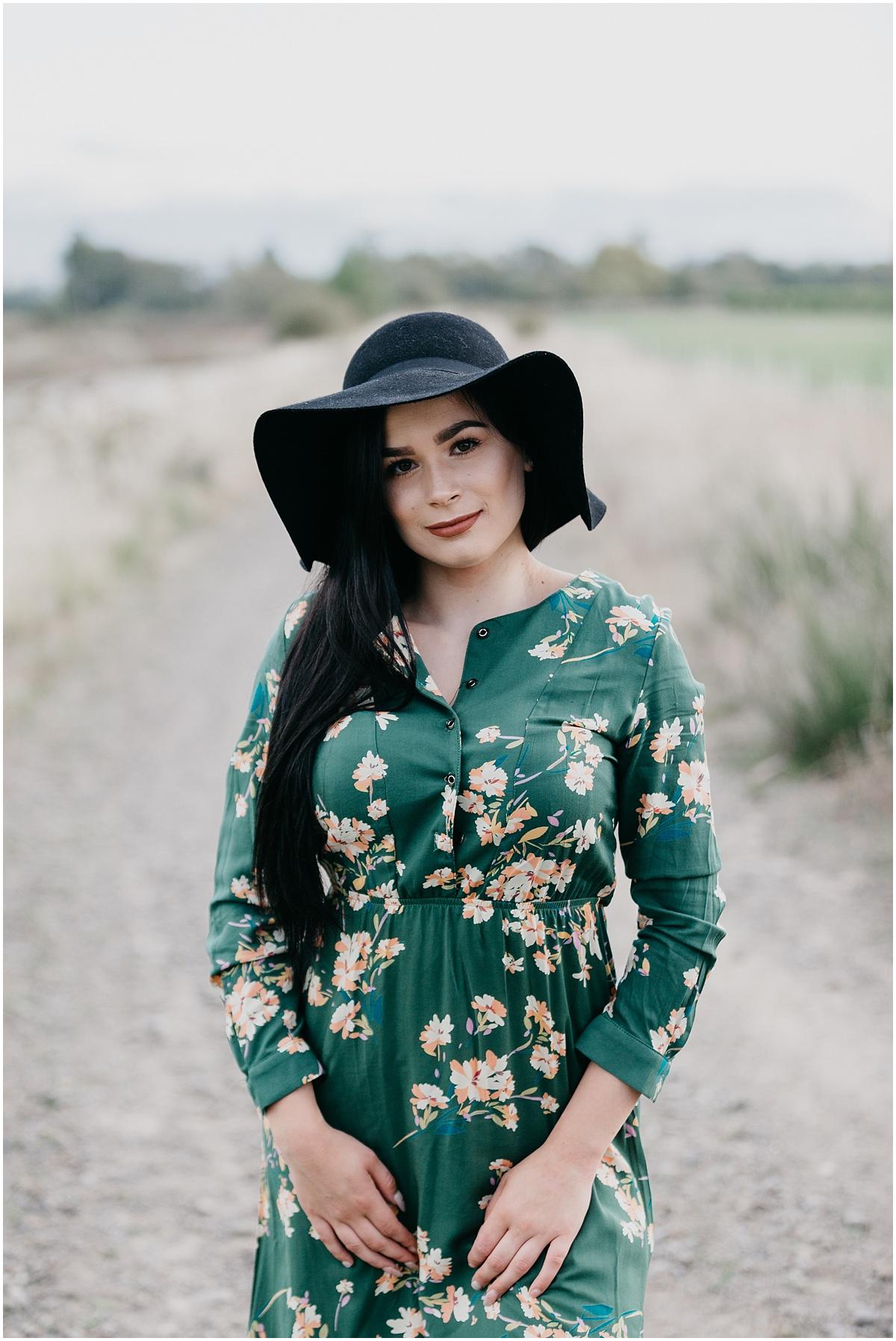 Girl in green flower dress summer evening