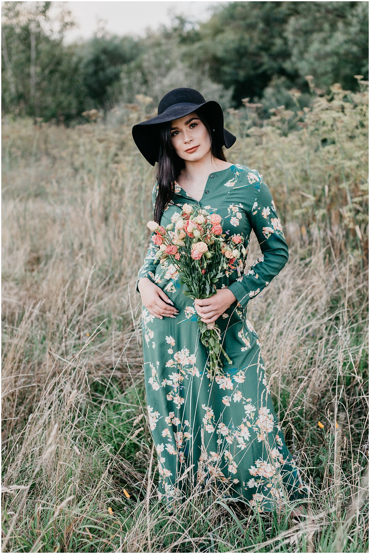 girl in green dress with flowers in grass