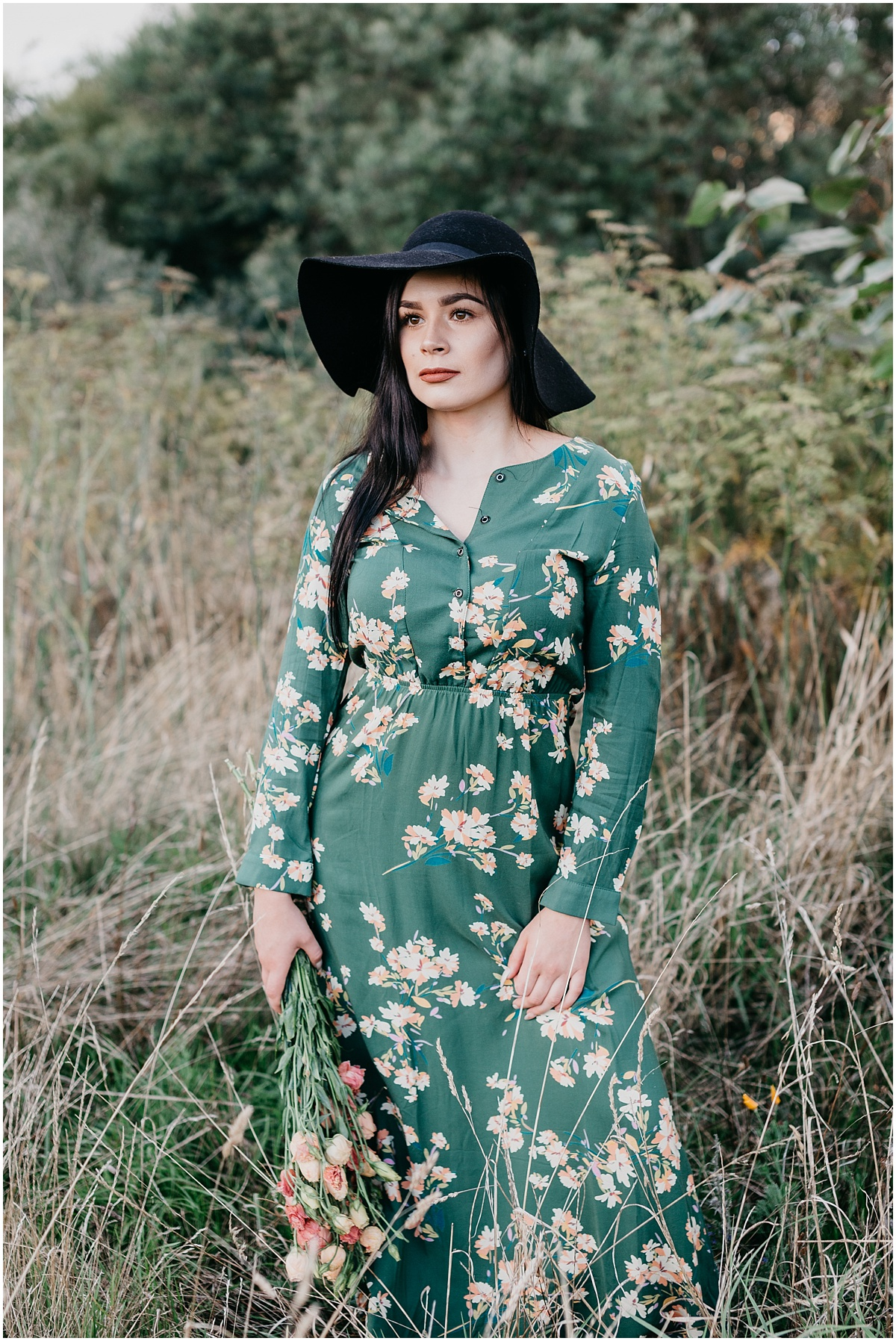 Girl with black hair and wearing black floppy hat