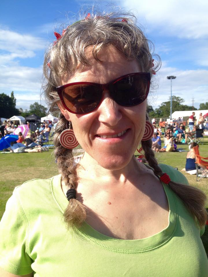 Gorgeous customer wearing her newly purchased Lumago earrings.