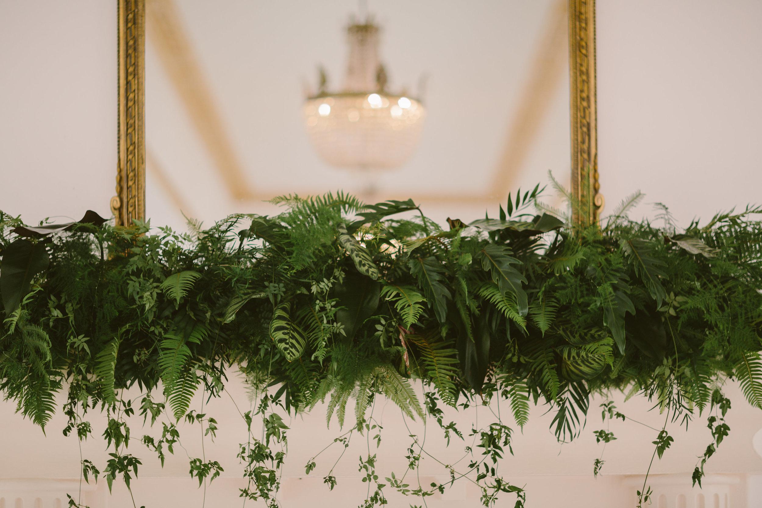 mantle piece flowers foliage jungle botanical wedding