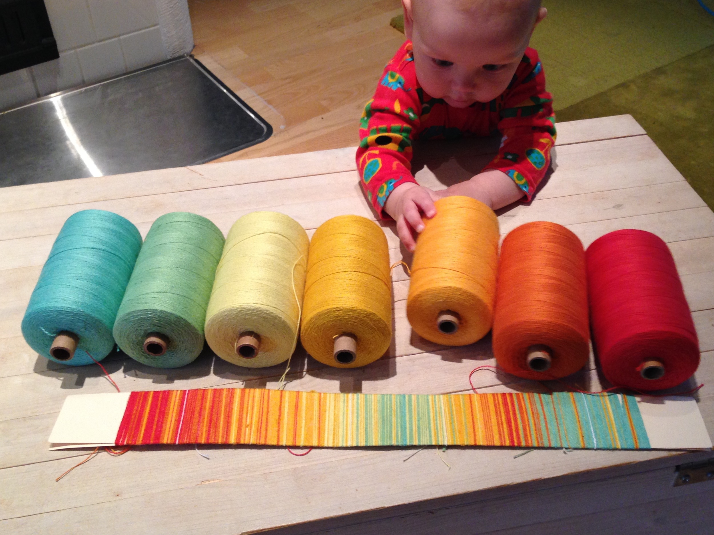 The Small Kid inspecting my colour choices.